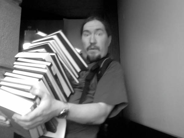 Image of Anthony Metivier struggling with books and trying to learn from them using rote learning