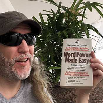 Anthony Metivier with a copy of Word Power Made Easy