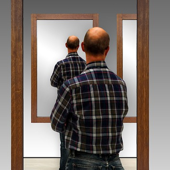 man in mirror to represent rote repetition feature image