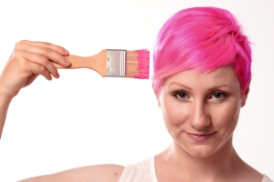 Woman painting her hair pink to illustrate a concept in brain training