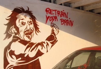Banksy image of Einstein spraypainting Retrain Your Brain