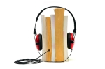 Image of Books with headphones to express the concept of the audiobook