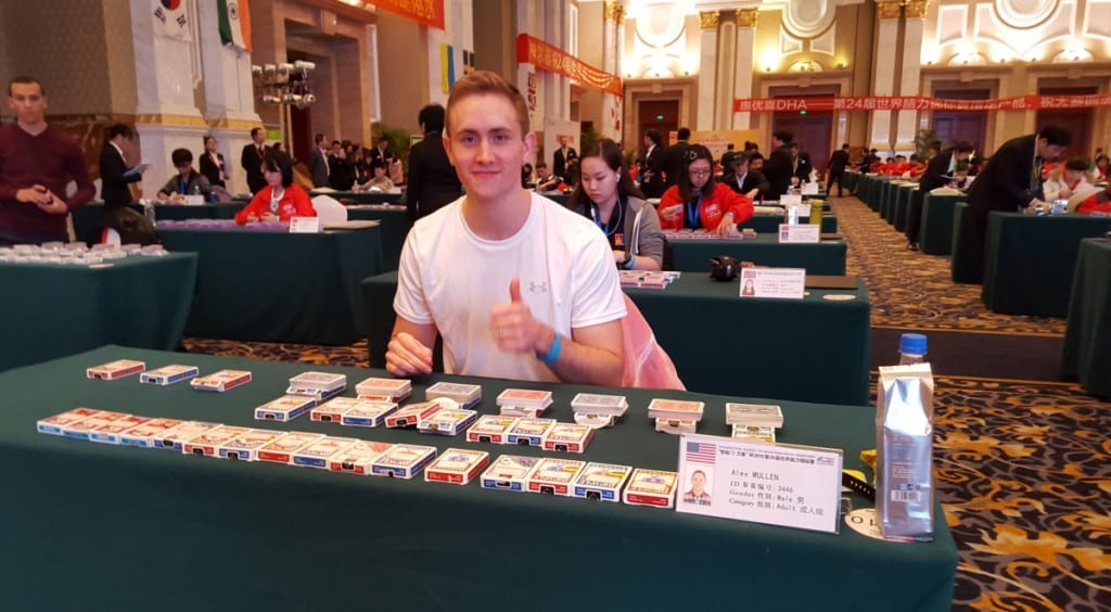Alex Mullen at a table with multiple packs of playing cards