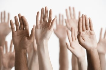 Image of hands raising to illustrate a point about focus and concentration