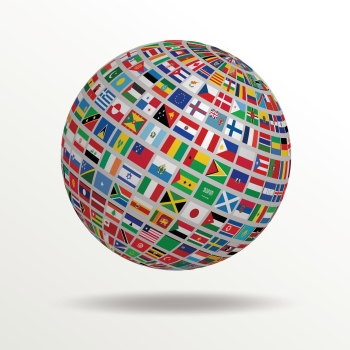 Image of a globe with many flags to express a Magnetic Memory Method concept related to bilingualism