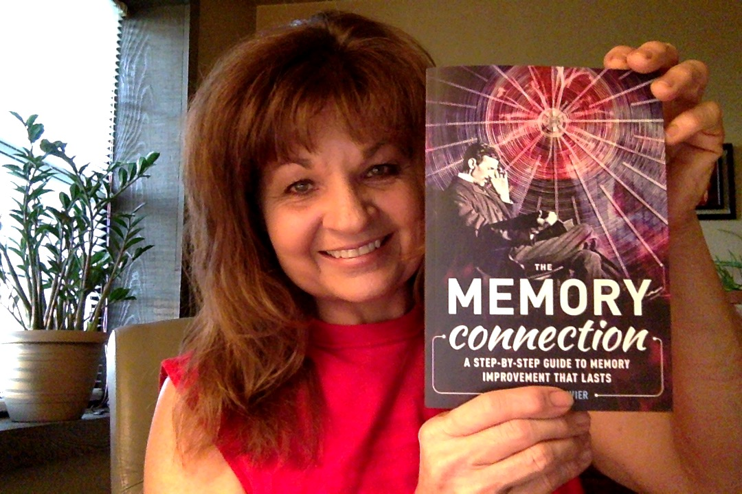 Debra with a copy of The Memory Connection by Anthony Metivier