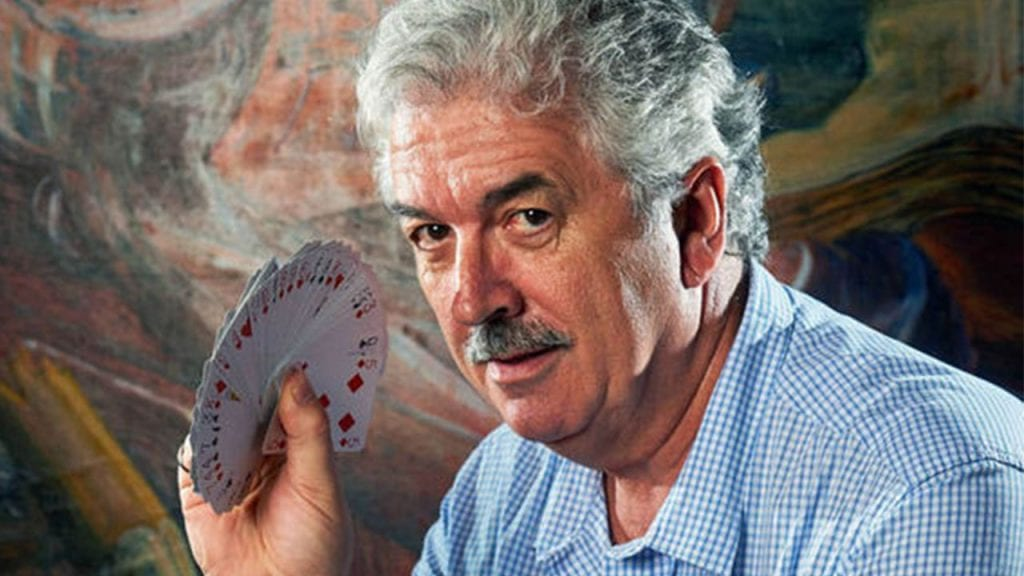 Dominic O'Brien with a deck of playing cards