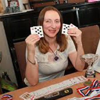 Katie Kermode with memory competition awards and playing cards