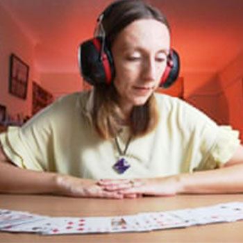 Memory Competitor Katie Kermode with a desk of playing cards