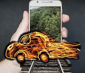 Image of a car blazing across train tracks to express a concept related to memory retention