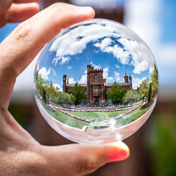 Image of a glass ball magnifying a mansion to express a concept related to the loci method