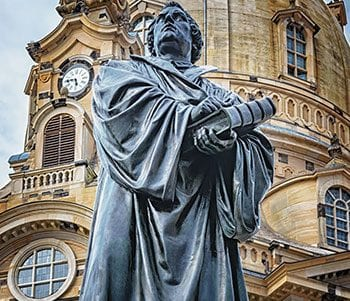 Dresden sculpture of man with Bible for Memorizing Psalms without a Memory Palace podcast