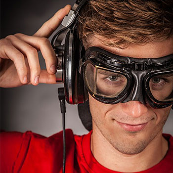 Feature image of a young man with goggles and headphones to demonstrate 3 kinds of neurobic exercise