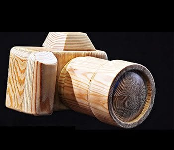 Image of a wooden camera for iconic memory blog post