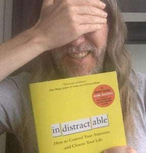 Anthony Metivier with a copy of Indistractable