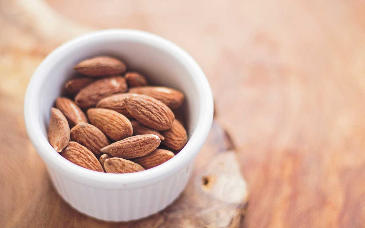 A bowl of almonds, which are high in Vitamin E.