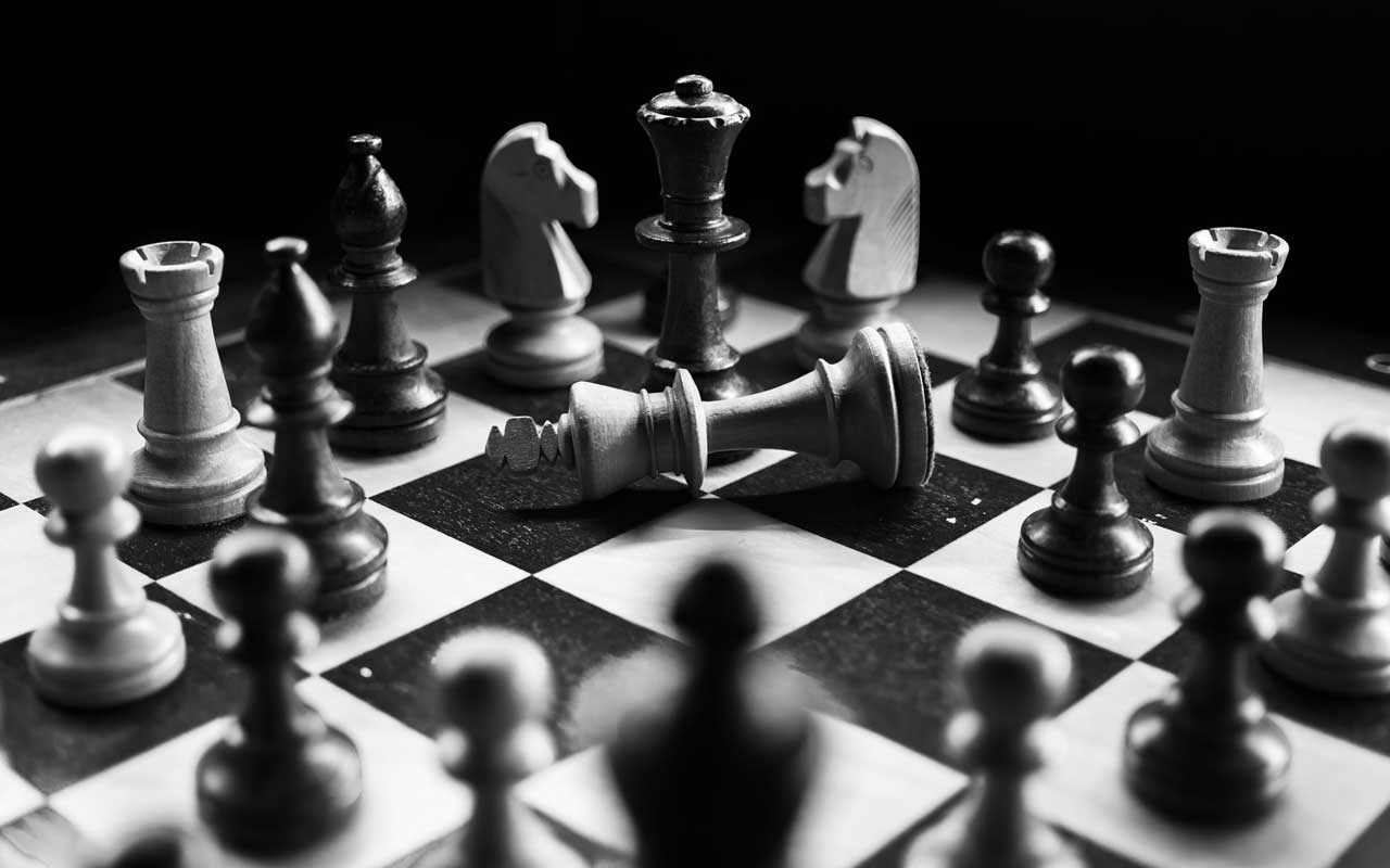 A black and white photo of a chess board. Chess can help you maintain cognitive skills as you age.