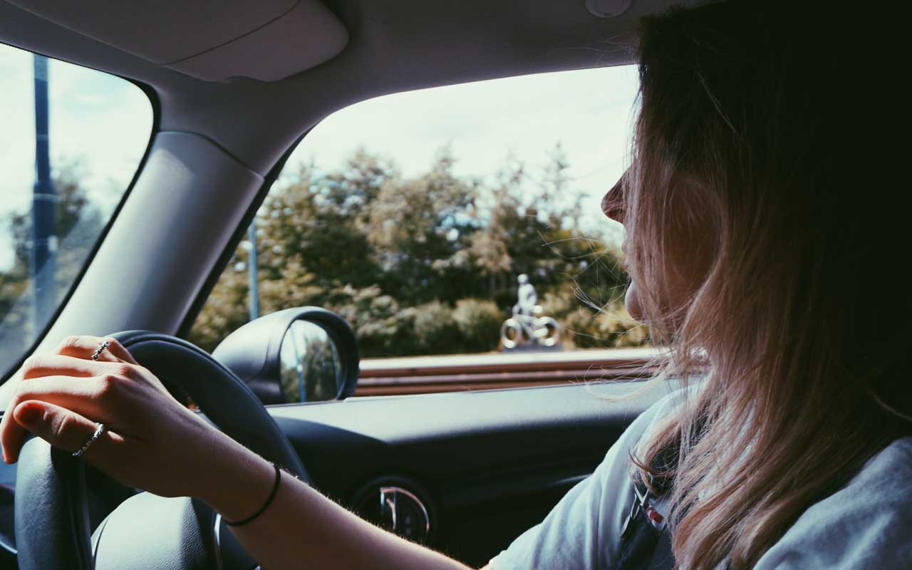 A woman driving a car; an example of a type of implicit memory.