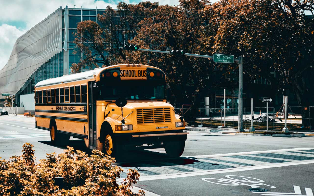 "A school bus crosses an intersection. An example of priming is to associate the word ""school"" with the image of a school bus."