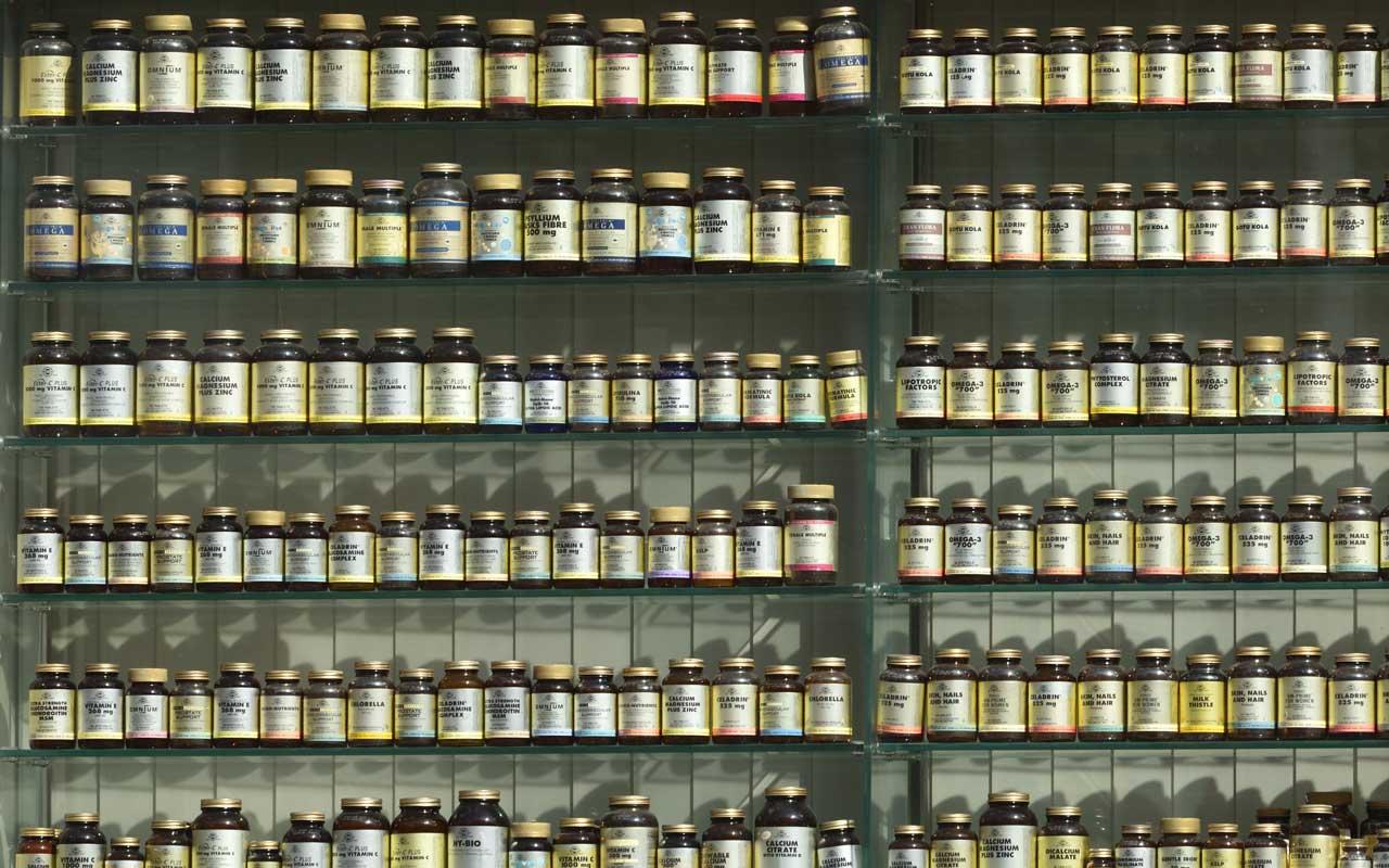 A wall of supplement bottles