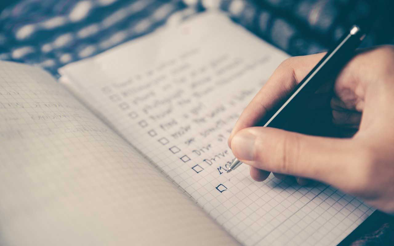 A person makes a checklist. One way to get your habits going and growing.