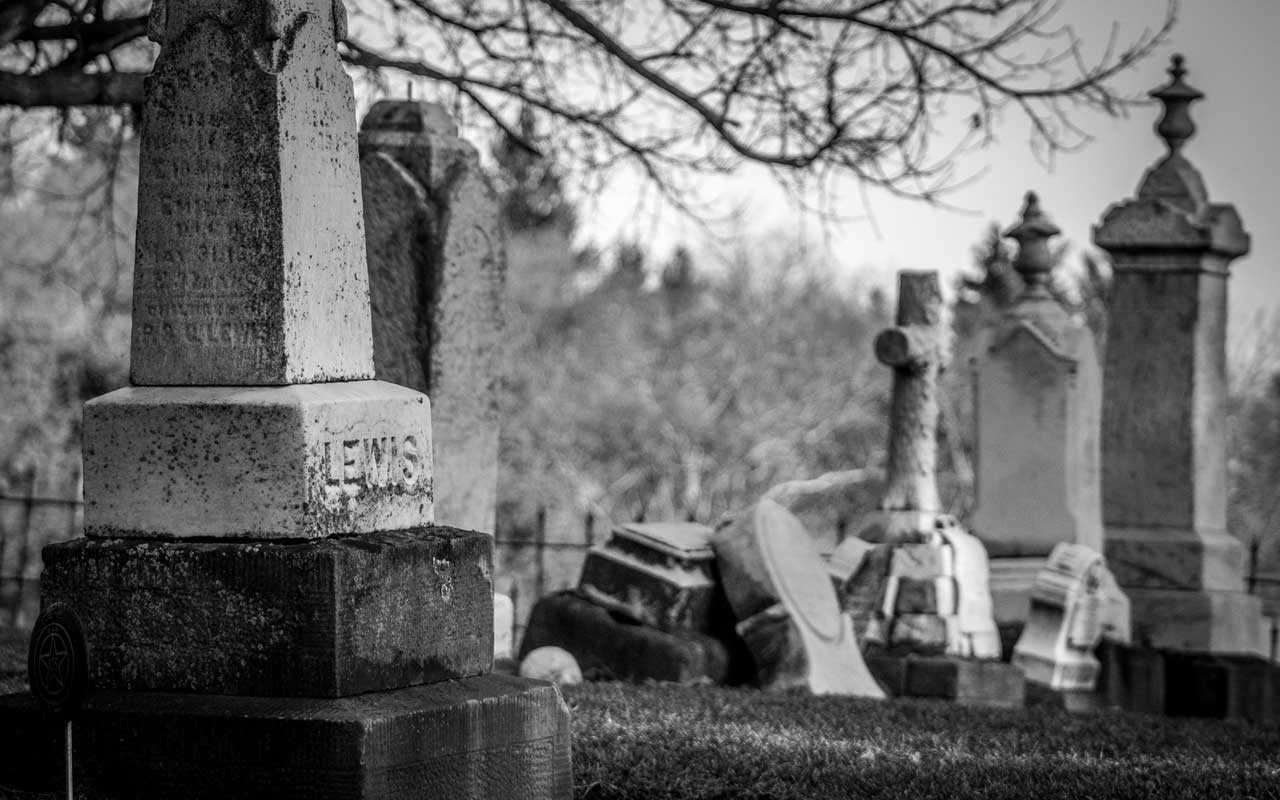 A black and white photo of a graveyard.