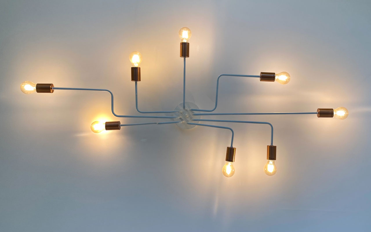 A modern light fixture in the shape of a mind map, with lights extending out in all directions.