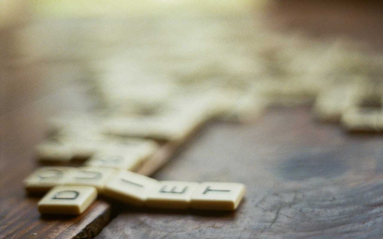 Scrabble tiles on a table, an example of games that can stimulate your brain.