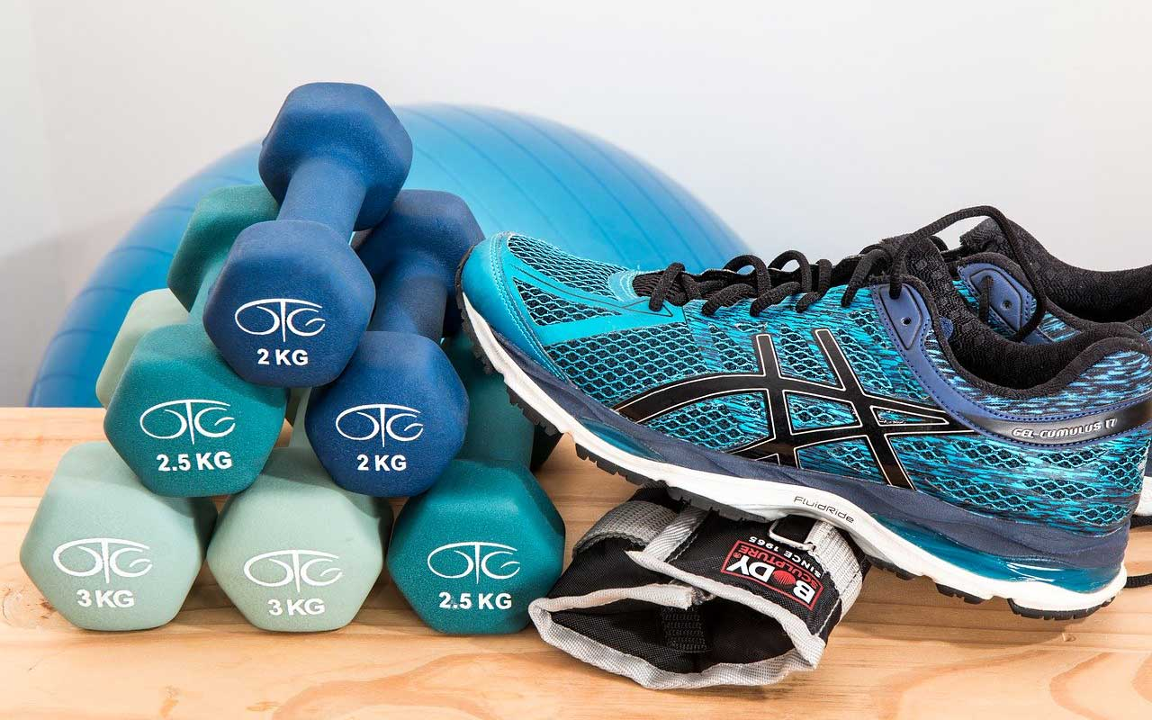 Exercise equipment, including a balance ball, dumbbells, and tennis shoes. Regular exercise is a great way to avoid long-term memory loss.