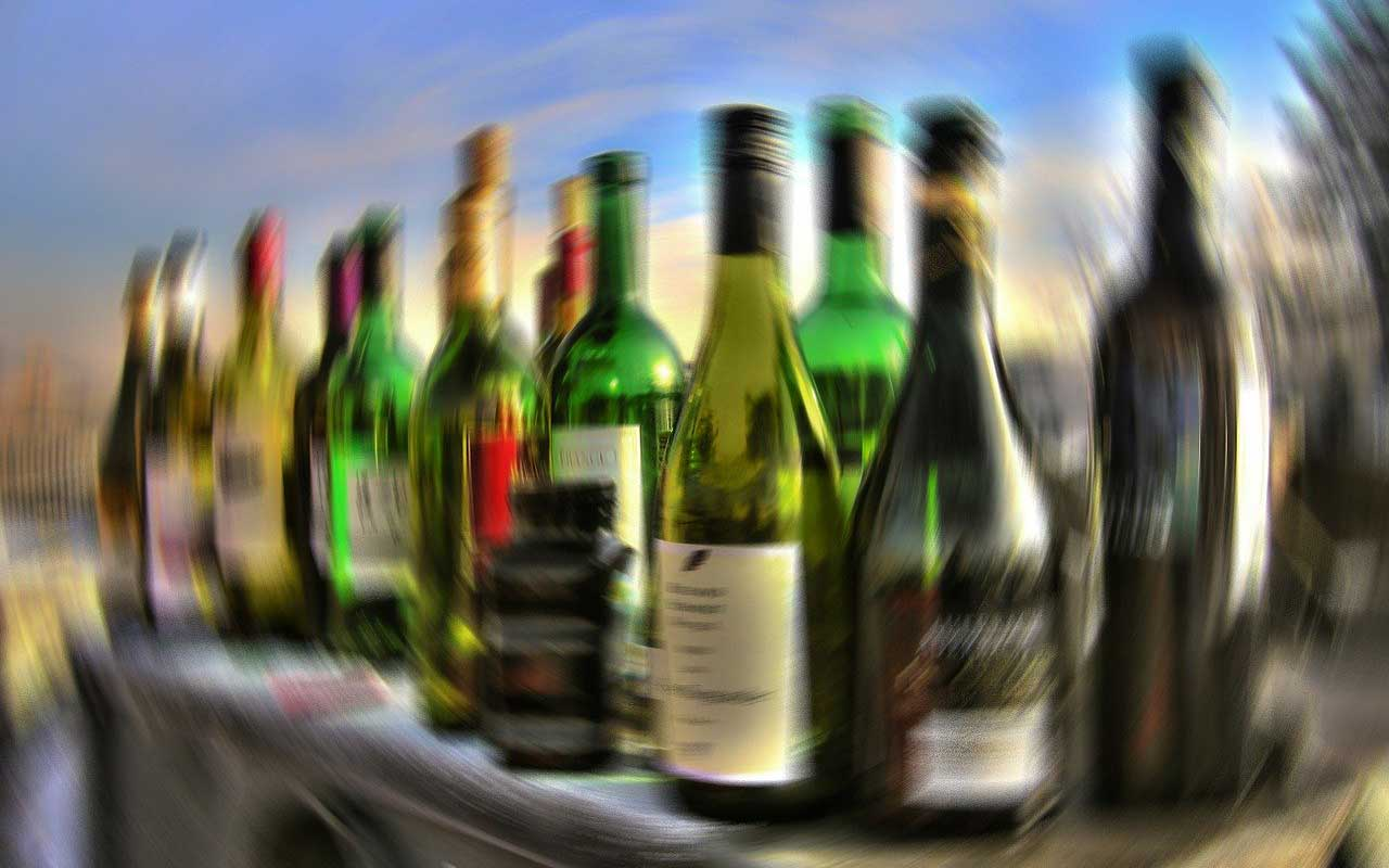 Blurry bottles, like the spinning sensation when a person has too much alcohol to drink.