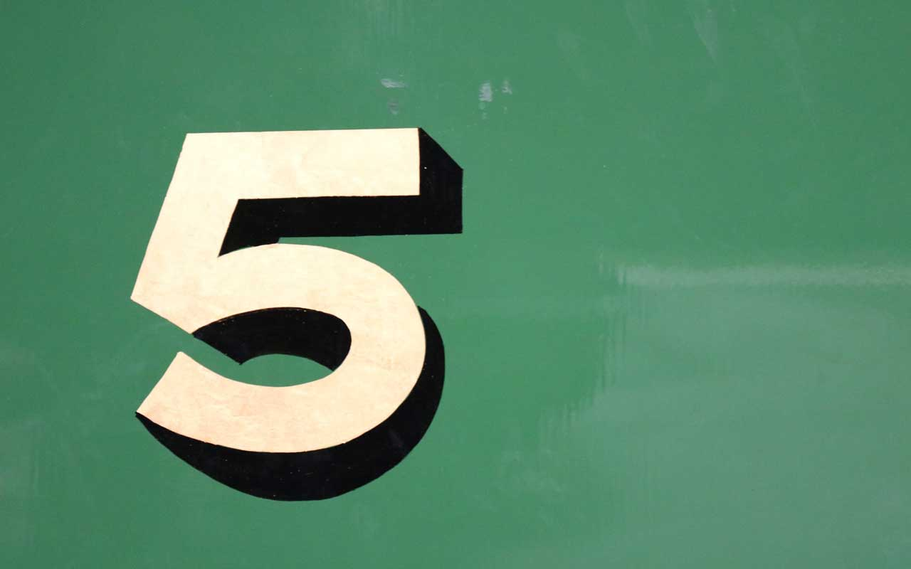 The number five, painted in gold and black against a green background. One of the foundational principles of the Magnetic Memory Method is the Rule of 5.