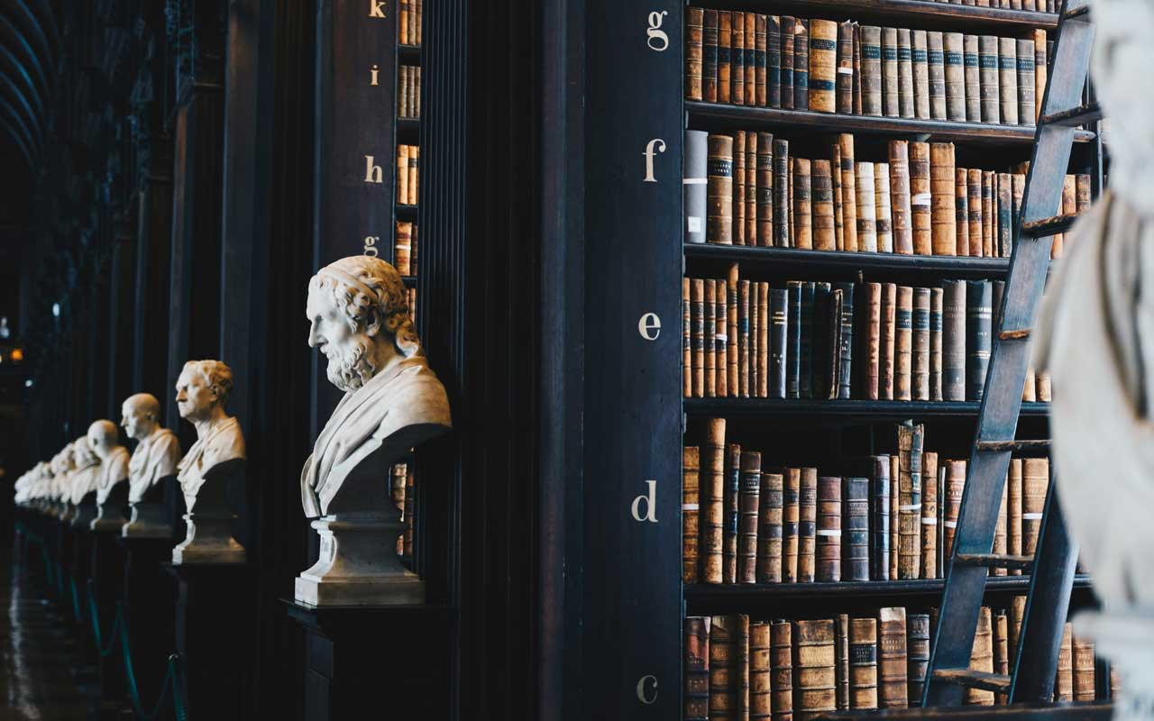 A library with busts of historical figures. Your memory strategies might include using the Dewey Decimal system as a Memory Palace.