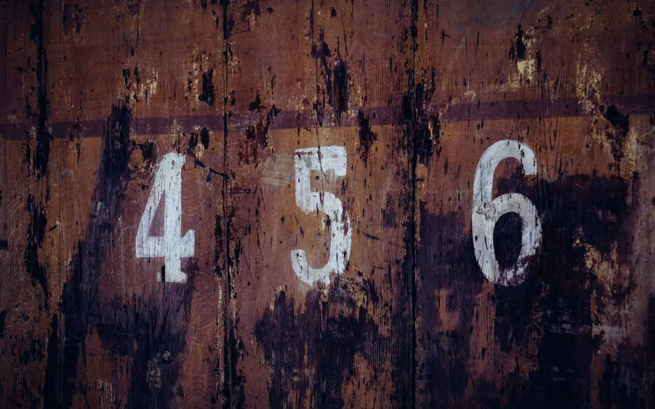 """The numbers 4, 5, and 6 painted on a surface. The number """"five"""" can be mapped to vowel sounds as part of the Major Method of memory."""