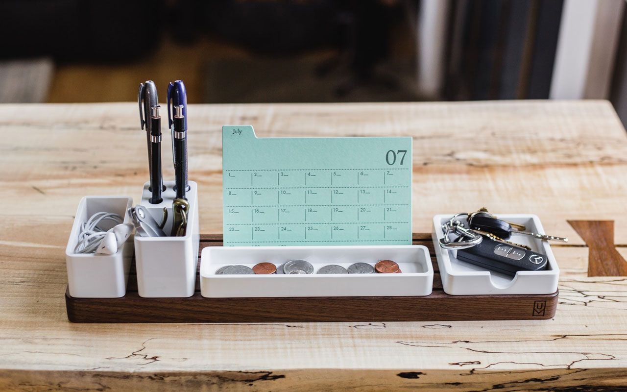 A desk organizer where you can keep all of your important things like keys, chargers, etc. Staying organized is an important part of your overall memory strategies.