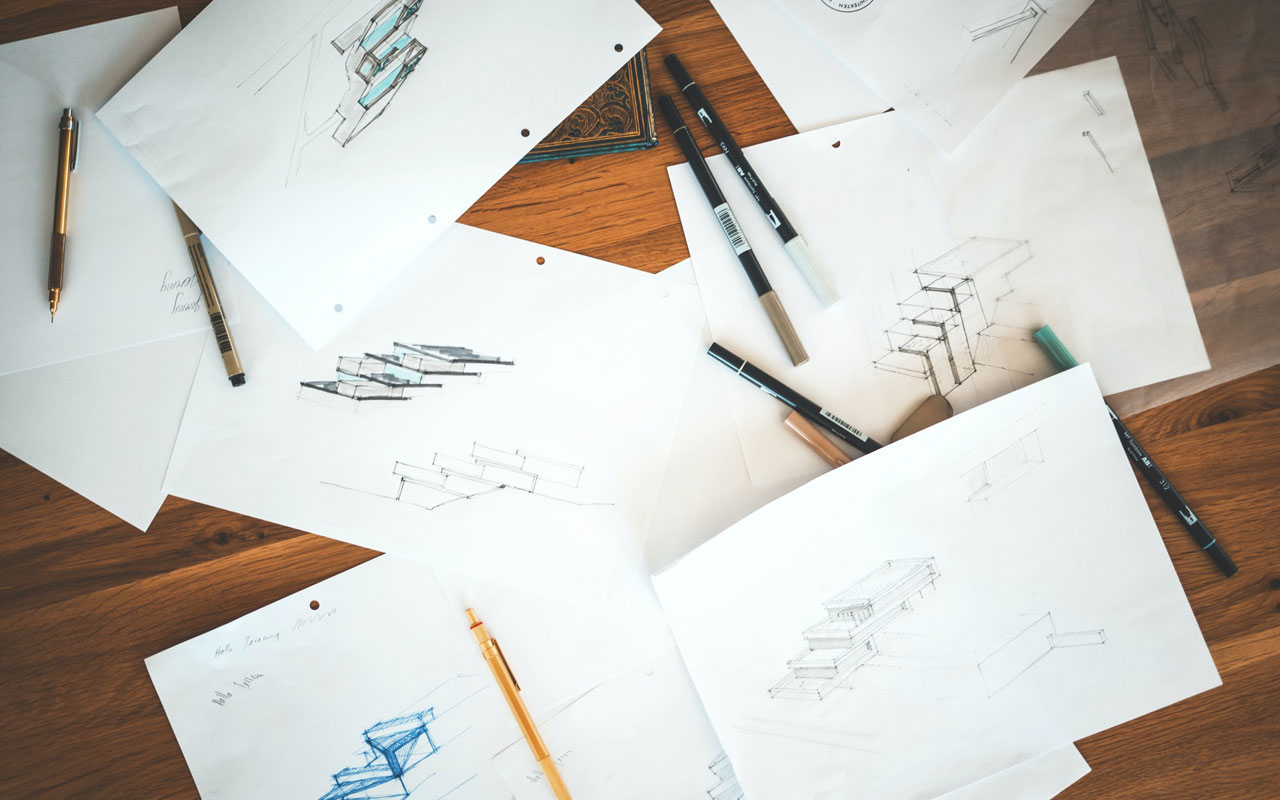 Ink sketches on a table. Visuospatial sketchpad is a way working memory stores information.