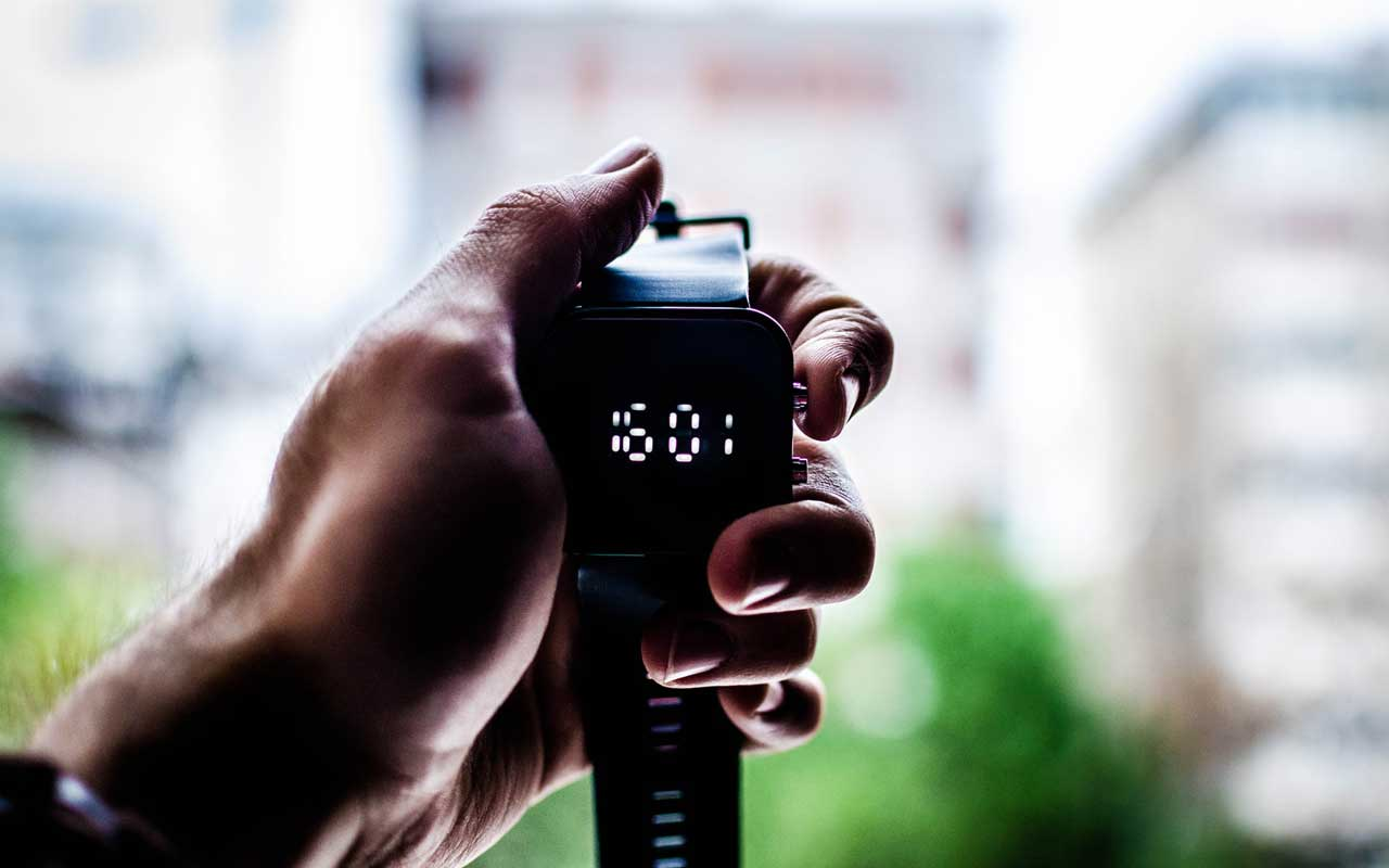 A person holds up a stopwatch. The speed at which you implement something new often determines whether you'll achieve your goal or not.