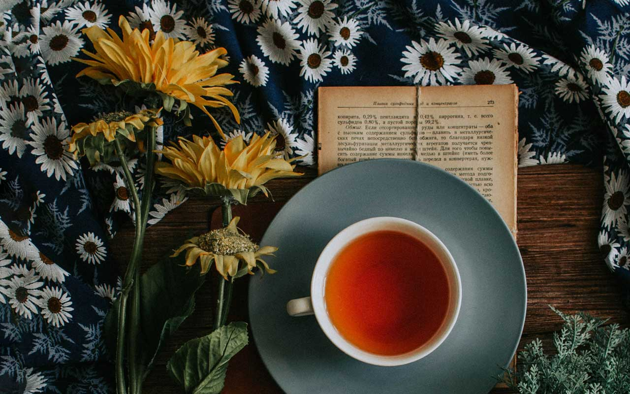 "A cup of tea, an open book, and a few sunflowers. You can ""sip"" your tea, and take it one SIP (study, implement, practice) at a time."
