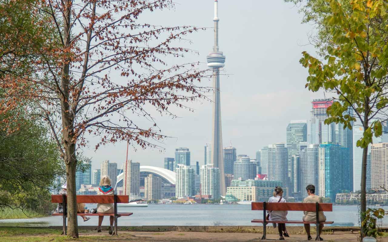 Two park benches near Lake Ontario in Toronto, Canada.