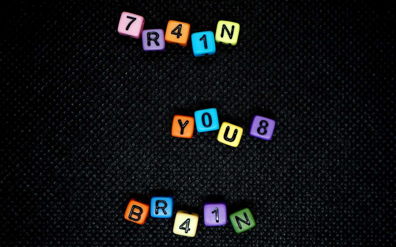 "7R41N YOU8 BR41N - small colored blocks spell out an alternate version of ""train your brain."""