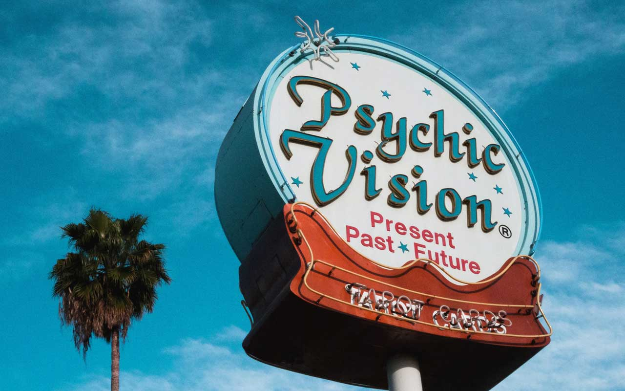 "A giant sign reads ""Psychic Vision, Present Past Future"" - not the kind of vision we're talking about today. ;)"