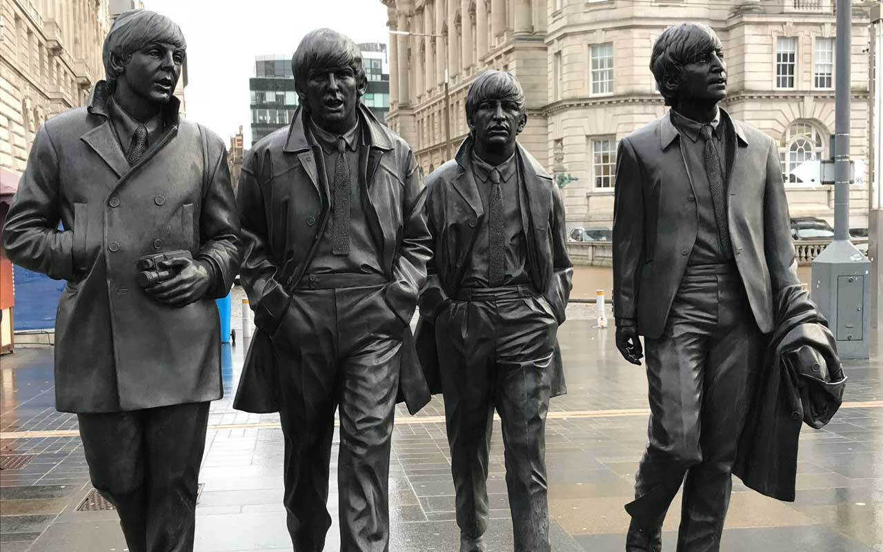 Statues of the Beatles in Liverpool, UK. The four band members can be used as part of your visualization reading strategy to start small.