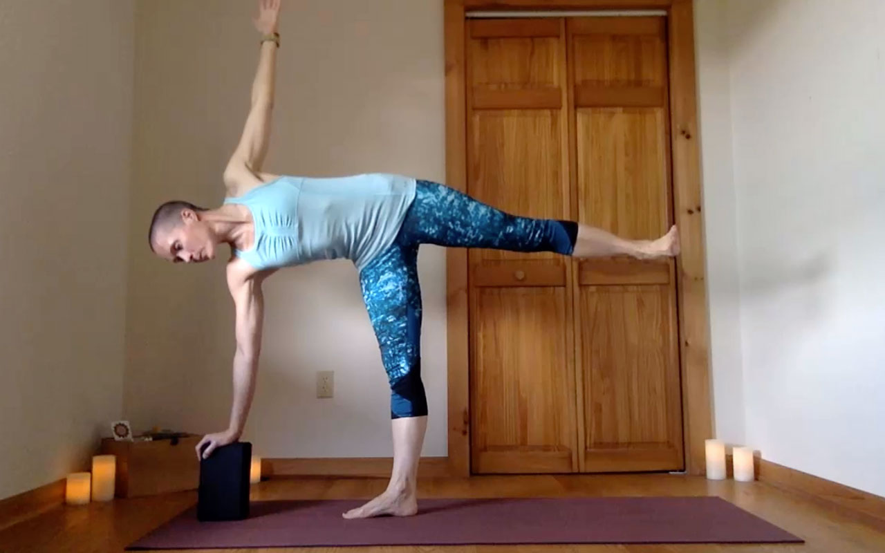 The pose author demonstrates Ardha Chandrasana (Half Moon).
