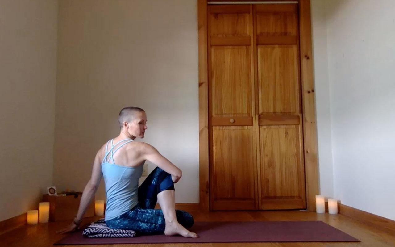The post author demonstrates Ardha Matsyendrasana (Half Spinal Twist).
