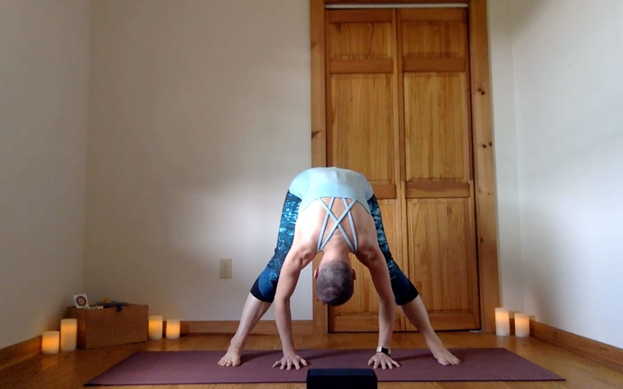 The post author demonstrates Prasarita Padottanasana (Wide-Legged Forward Fold).