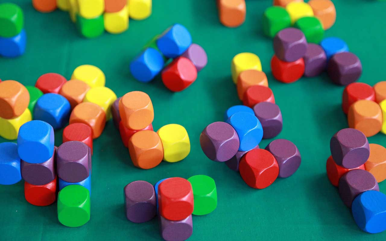 A stack of colorful magnetic building blocks. Long-term memory can be improved by combining memory techniques.