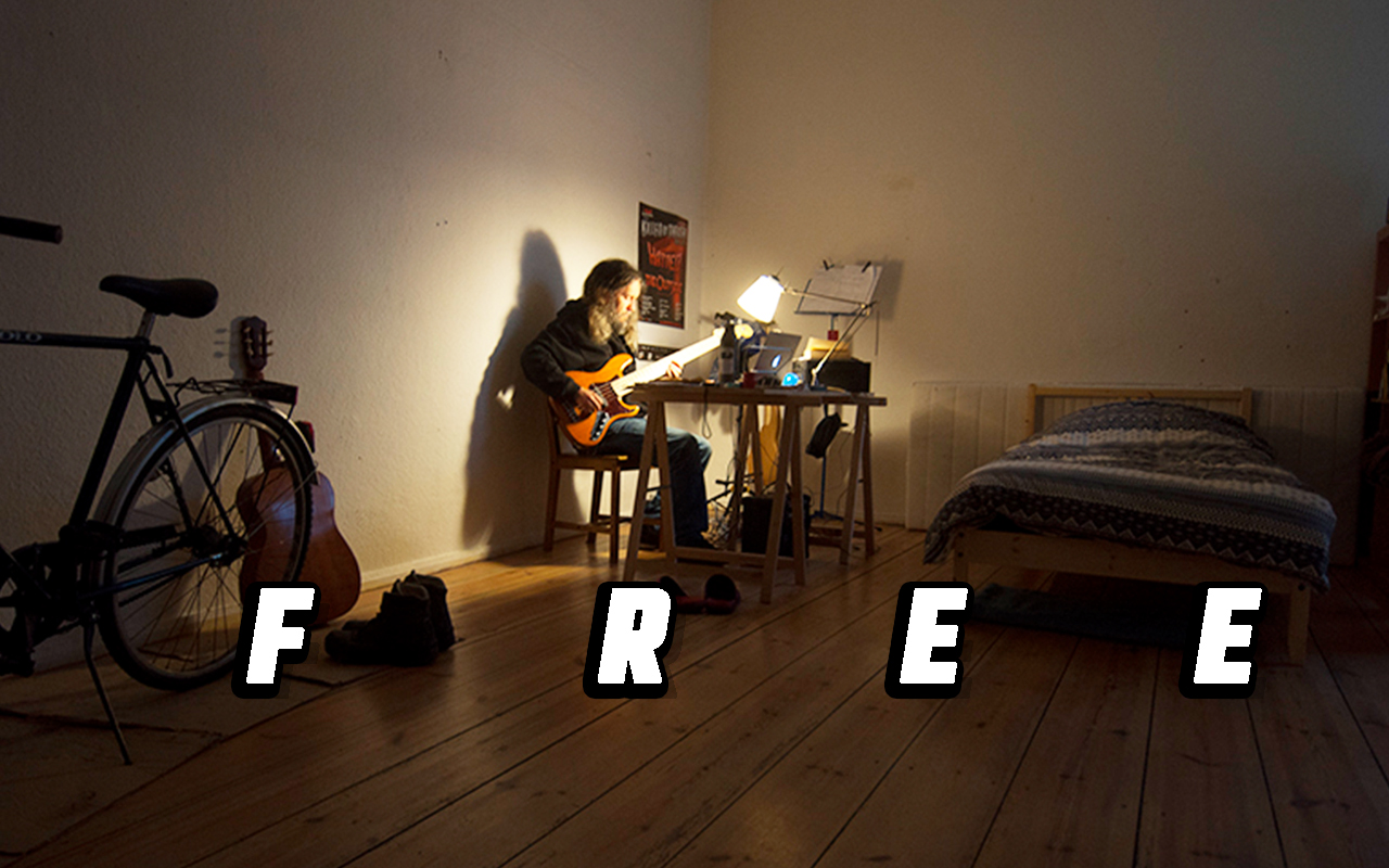 A photo of Anthony with a guitar at his desk, including his F.R.E.E. mnemonic device.