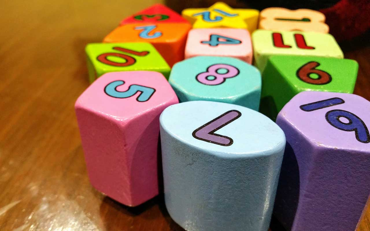 Colorful blocks with numbers painted on them. The Major Method is a powerful memory technique that helps with memorizing numbers.