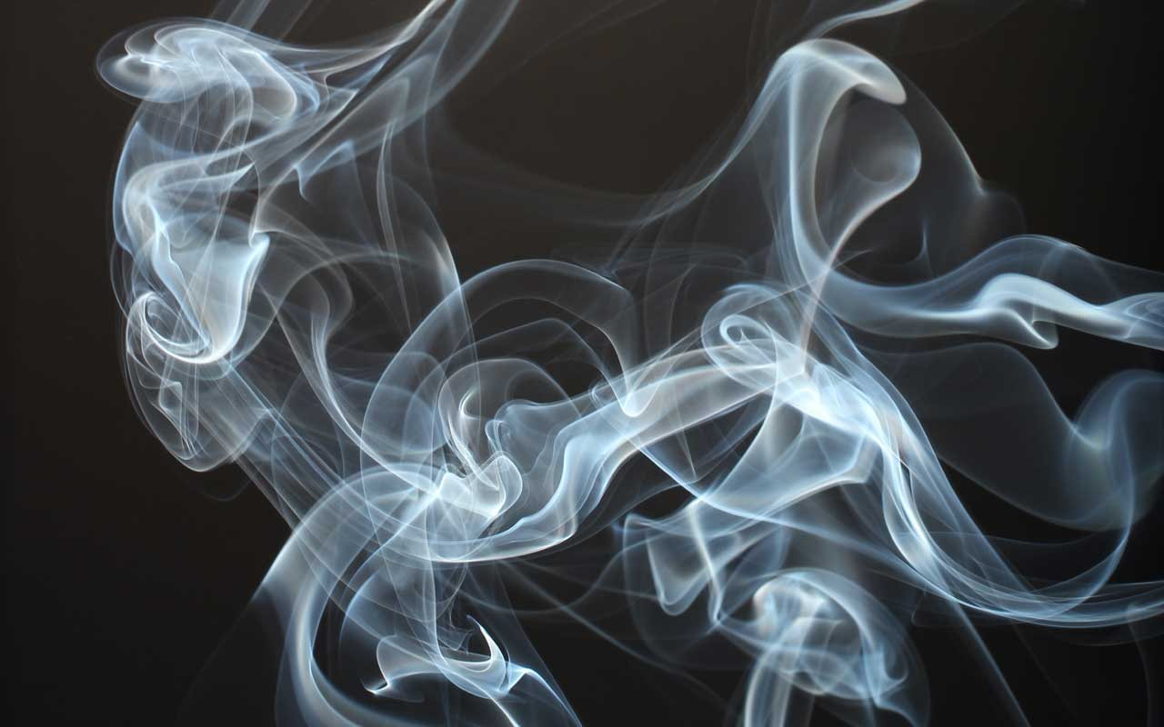 A cloud of smoke vapor hangs in the air. Smoking and vaping can impair your memory.