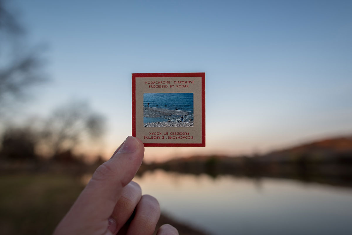 A person holds up a square Kodachrome negative. The square represents the even count of inhale, exhale, and breath retention in sama vritti pranayama (box breathing).