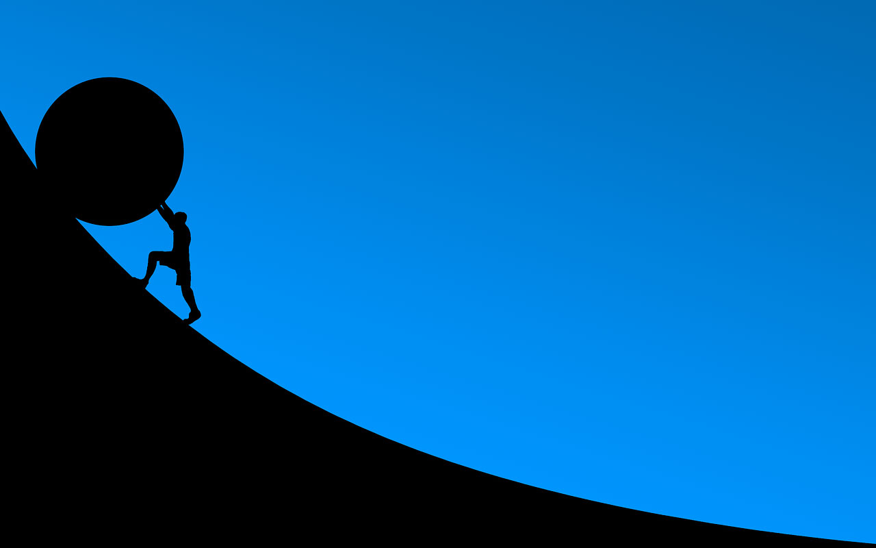 A graphic of a person pushing a large round object up an increasing slope.
